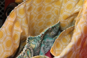 I used Joel Dewberry Laminated Cotton for the lining and Frog Prince in Honey for the pocket linings.