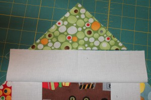 Fold the HST and strip in half to find the center, pin and sew RST.