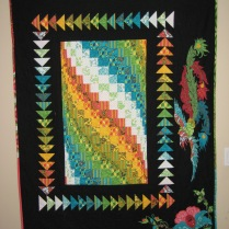 Circa 2009 Flights of Fancy. The fabric is Tula Pink Nest., and those are 3D flying geese!
