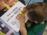 Casting his ballot for his favorite quilt!